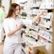 Stock Photo: Pharmacist Filling Prescription