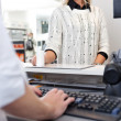 Customer Standing at Checkout Counter — Stock Photo #9180723