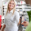 Female Pharmacist With A Customer In Pharmacy - Stock Photo
