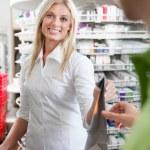 Female Pharmacist With A Customer In Pharmacy — Stock Photo