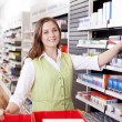 Stock Photo: Pharmacist Looking For Medicine
