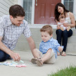 Stock Photo: Father and Son Playing on Sidewalk