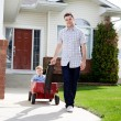 Father Pulling Son Sitting Inside Wagon — Stock Photo #9184687