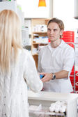 Male Pharmacist With A Customer In Pharmacy — Stock Photo