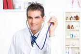 Male Doctor Holding Stethoscope — Stock Photo