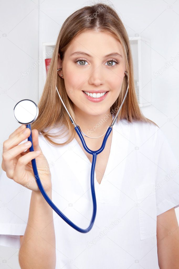 Female doctor with a stethoscope listening. — Stock Photo #9180950