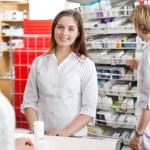 Pharmacist Attending Customer at Counter — Stock Photo
