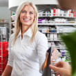 Female Pharmacist With A Customer In Pharmacy — Stock Photo #9314421