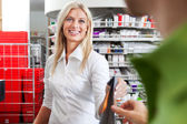 Female Pharmacist With A Customer In Pharmacy — Stock Photo