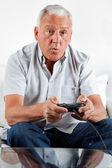 Senior Man Playing Video Game — Stock Photo