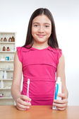 Girl Holding Toothbrush and Tooth Paste — Foto Stock