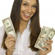 Attractive business woman holding dollars — Stock Photo #8027777