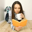 Young woman reads a book — Stock Photo #8125282