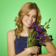 Attractive girl hugging a bouquet of iris — Stock Photo