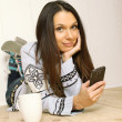 Young woman at home with the phone - Stock Photo