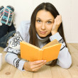 Young woman reads a book — Stock Photo #9111004