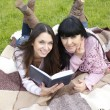 Mom and daughter reading a book — Stock Photo #9448348