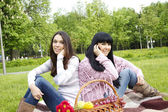 Mother and daughter talk on the phone in the park — Stock Photo