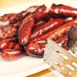 Stock Photo: Grilled sausage served on plate