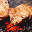 Stock Photo: Pork chops on grill