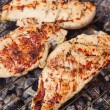 Stock Photo: Marinated chicken steaks on grill