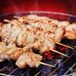 Stock Photo: Pork skewers on grill
