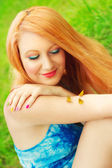 Redhead in a green meadow — Stock Photo