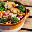 Mushroom and broccoli stir-fry — Stock Photo