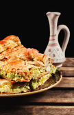 Traditional homemade balkan leek and cheese pie served with rakija — Stock Photo
