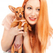 Woman holding a miniature pincher puppy — Stock Photo