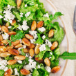 Lettuce, almond and cheese salad closeup - Stock Photo