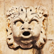 Sculpted stone mask figure on ancient fountain on the side of Church of Saint Blaise (St.Vlaha) Dubrovnik — Stock Photo