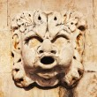 Sculpted stone mask figure on ancient fountain on the side of Church of Saint Blaise (St.Vlaha) Dubrovnik - Stock Photo
