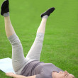 Middle aged woman exercising — Stock Photo