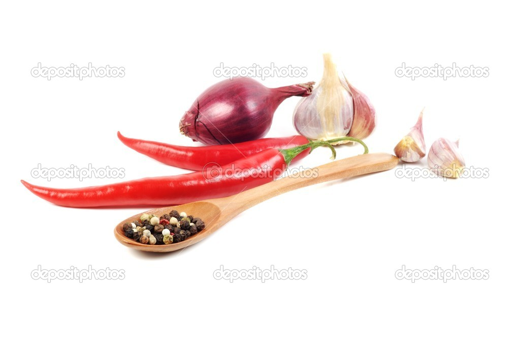 Pepper in a wooden spoon and spice , on a white background — Stock Photo #8987449