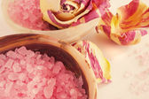 Aromatic salt for a bath and rose-petals — Stock Photo