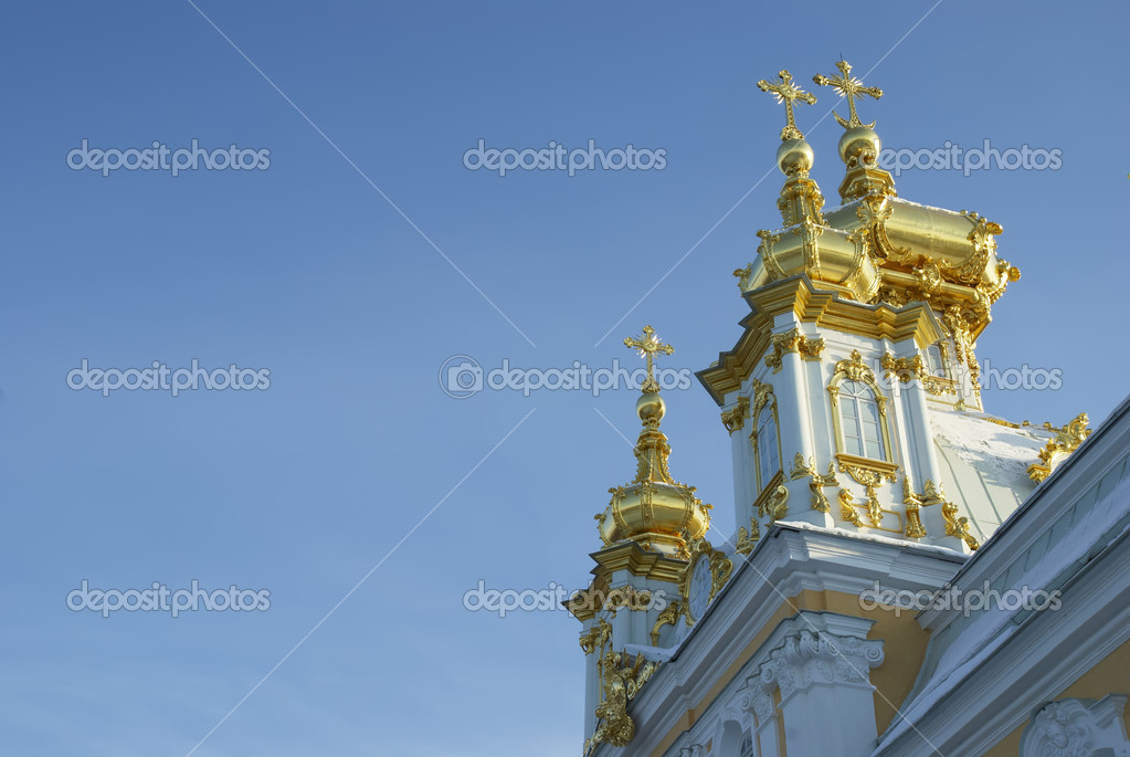 Gilded domes of orthodox church of palace complex in Petergofe on a background sky.  Stock Photo #9247523