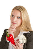 Pensive Woman With Fresh And Canned Vegetables — Stock Photo