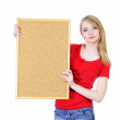 Young blond woman holding a cork board - Stockfoto