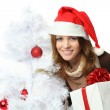Christmas - woman in santa hat with gift boxes — Stock Photo
