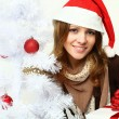 Stock Photo: Smiling woman with Xmas tree - Christmas