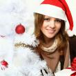 Smiling woman with Xmas tree - Christmas — Stock Photo