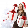 Smiling woman with gift and Christmas tree isolated — Stock Photo