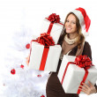 Stock Photo: Smiling woman with gift and Christmas tree isolated