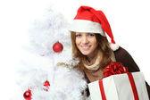 Jul - kvinna i santa mössa med presentaskar — Stockfoto