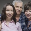 Daughter and seniors parents - smiling family — Stock Photo