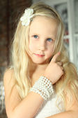 Child with blond hair - beautiful young girl close-up — Stock Photo