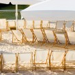 Row of chairs on beach cafe — Stockfoto