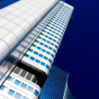 Skyscraper vanishing in blue sky — Stock Photo #10166179