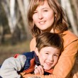 Stock Photo: Mother and son outdoor set